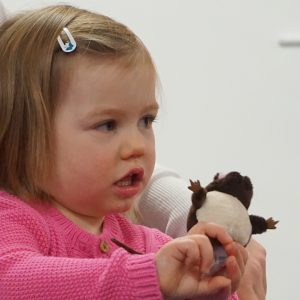 Toddler with mouse finger puppet.