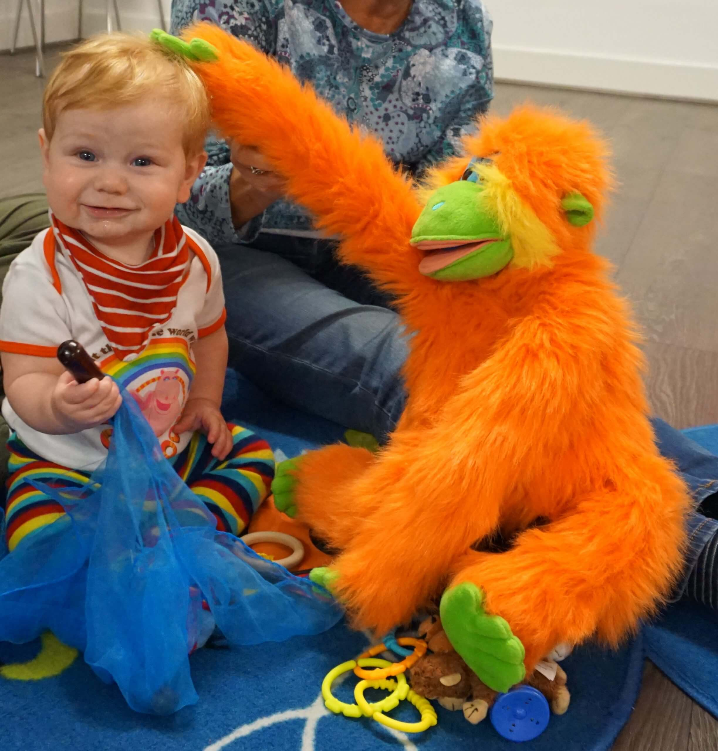 Happy Baby with monkey puppet and instruments