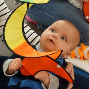 Baby with colourful spinner eye tracking.